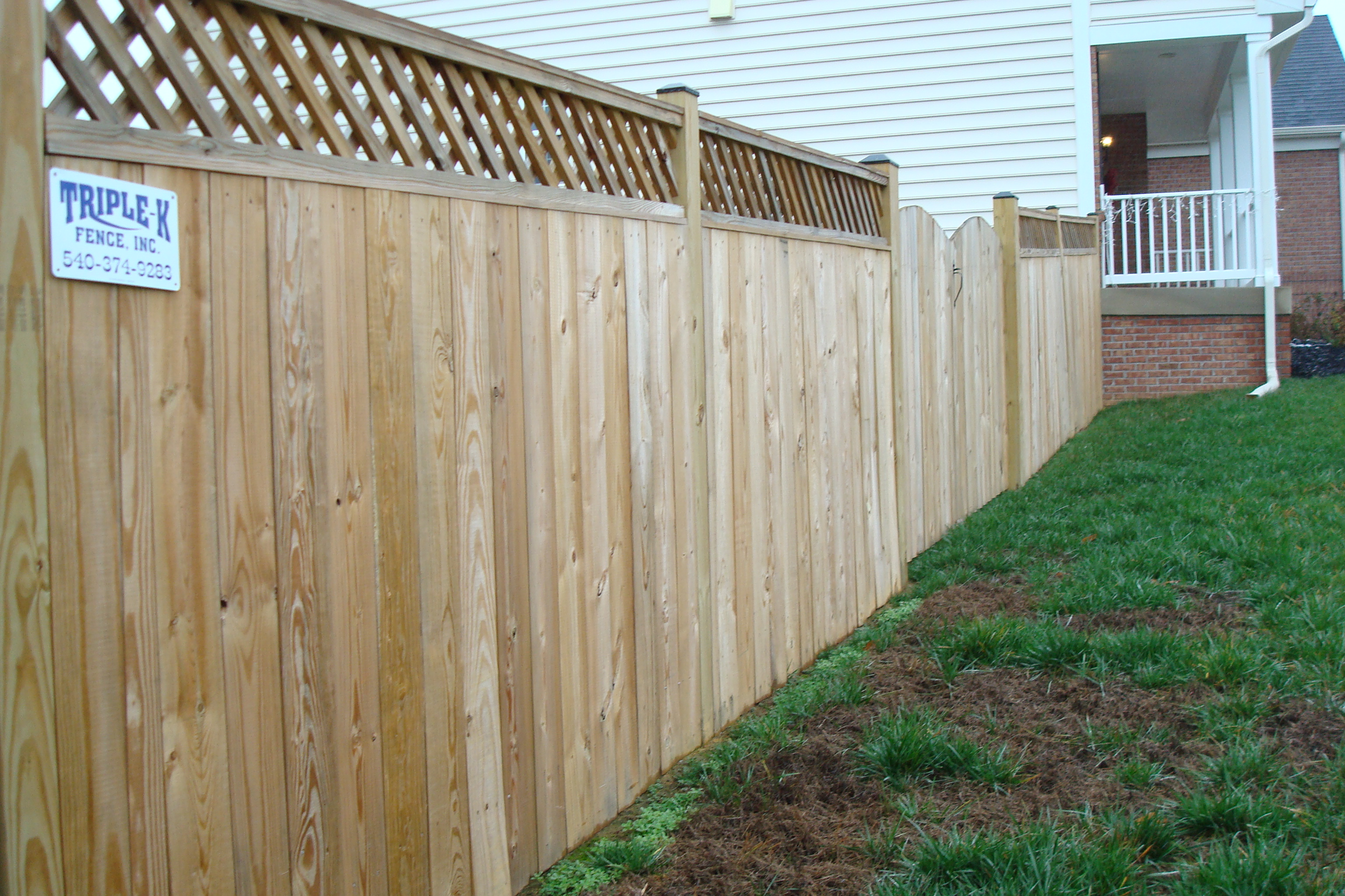 Wood fences triple k fence lattice top privacy with caps drive gate baanklon Choice Image